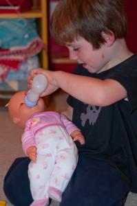 boy holding doll
