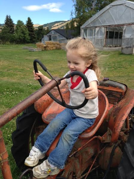 little girl on tractor