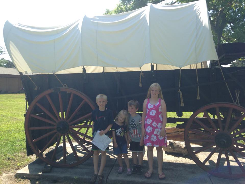 Fort Kearney, covered wagon, oregon trail stops, kids near covered wagon, oregon trail field trip